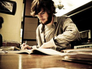 image of a young man studying