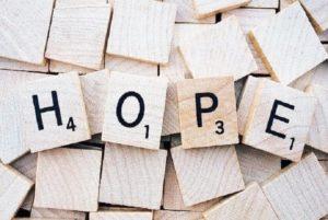 """wooden scrabble tiles spelling """"HOPE"""""""