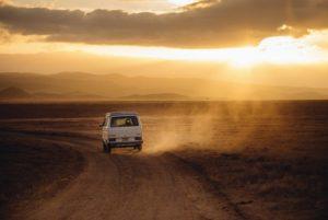 van drives unto sunset