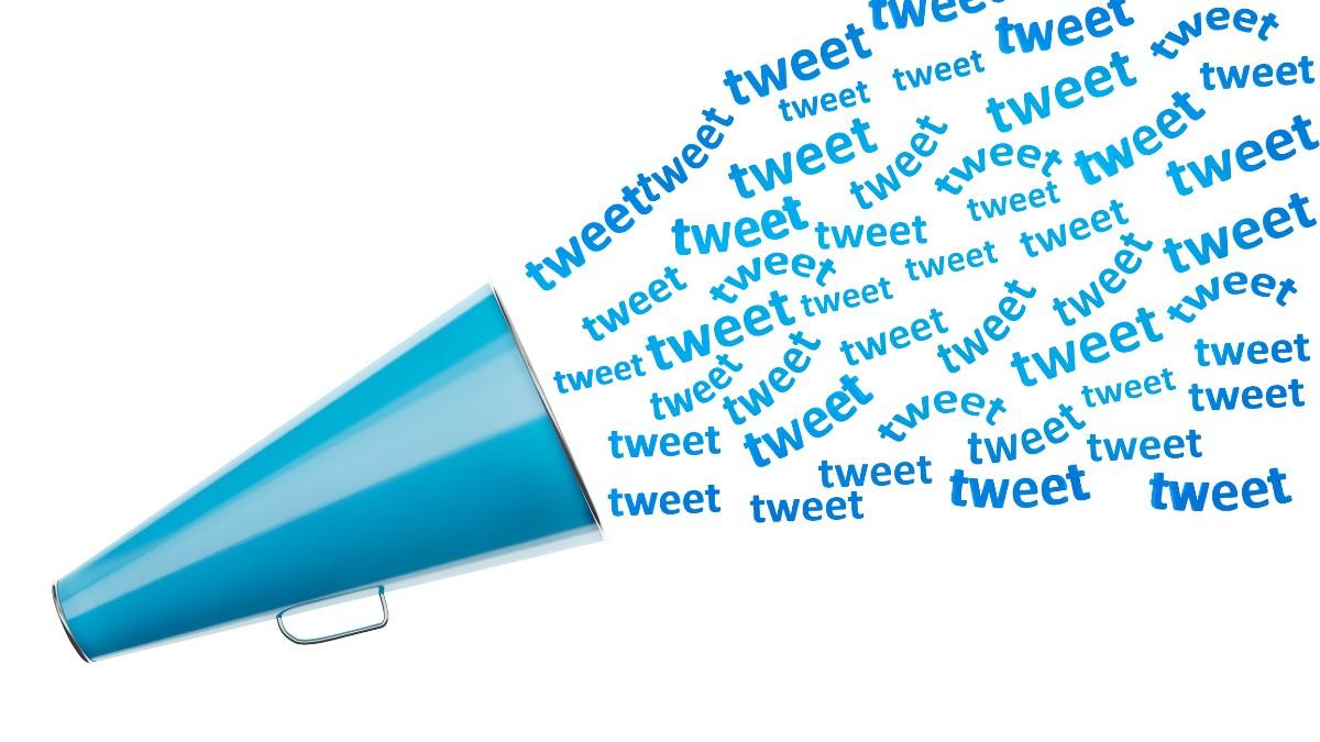 Megaphone with tweet written many times in twitter style