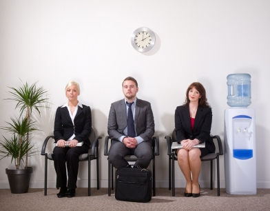 3 smartly dressed people sitting waiting to be called for interview
