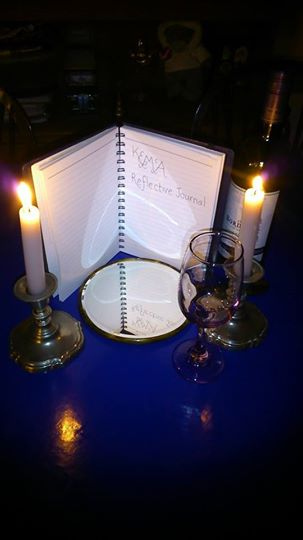 Reflective journal by candlelight