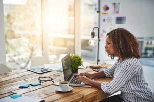 Female writer sitting at laptop